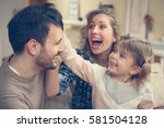 happy family spending time with ... | Shutterstock . vector #581504128
