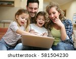 happy family spending time at... | Shutterstock . vector #581504230