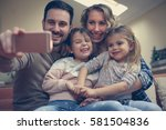 family taking self portrait on... | Shutterstock . vector #581504836