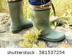close up two feet in green... | Shutterstock . vector #581537254