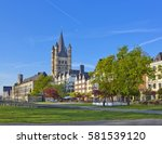 Small photo of Old buildings on the Rhine embankment in Cologne, Germany with Great St Martin church