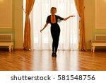 rear view of sporty woman... | Shutterstock . vector #581548756