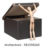Small photo of Who seeks will always find. Wooden lay figure looks in cardboard box, isolated on white background.
