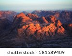 sunrise at the top of mount... | Shutterstock . vector #581589409