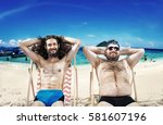 two nerdy guys on vacation | Shutterstock . vector #581607196