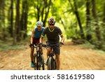 two mountain bikers riding bike ... | Shutterstock . vector #581619580