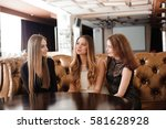 young friends in a cafe | Shutterstock . vector #581628928