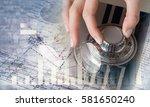 woman open safe . mixed media | Shutterstock . vector #581650240