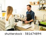 good looking male barista...   Shutterstock . vector #581674894