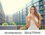 summer in the city. pretty... | Shutterstock . vector #581675944