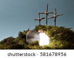Small photo of resurrection garden as easter decoration with a stone near the empty tomb filled with blinding light and three crosses on a hill above