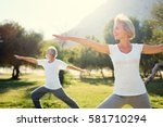 Stock photo yoga at park senior family couple exercising outdoors concept of healthy lifestyle 581710294