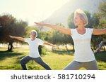 Yoga At Park. Senior Family...