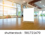 table tent on wooden table   Shutterstock . vector #581721670