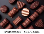 line of chocolates of different ... | Shutterstock . vector #581735308