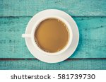 top view cup of coffee on blue... | Shutterstock . vector #581739730