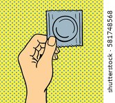 pop art hand with condom vector ... | Shutterstock .eps vector #581748568