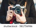 Hipster Man Photographer Takin...