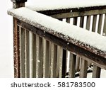 Small photo of Snow accumulated on a wooden deck