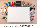 notebook over school supplies...   Shutterstock . vector #581788210