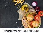 craft beef burgers on round... | Shutterstock . vector #581788330