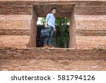 the man stands at the door of... | Shutterstock . vector #581794126