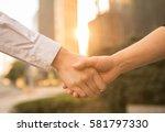 business people shake hands... | Shutterstock . vector #581797330