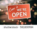 we are open sign hanging on a... | Shutterstock . vector #581830984