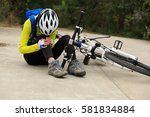 female cyclist getting injured... | Shutterstock . vector #581834884