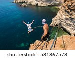 rope jumping off a cliff with a ... | Shutterstock . vector #581867578