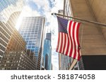usa flag in chicago with with... | Shutterstock . vector #581874058