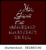 the font on a dark red... | Shutterstock .eps vector #581885140