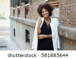 young black woman with afro... | Shutterstock . vector #581885644