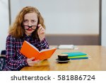young serious female student in ... | Shutterstock . vector #581886724