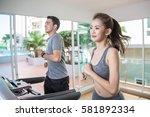 young asian sporty women run on ... | Shutterstock . vector #581892334