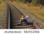 depressive woman sitting on a... | Shutterstock . vector #581912506
