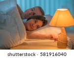 the woman lay on the bed with... | Shutterstock . vector #581916040