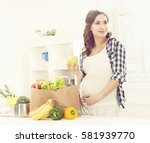 beautiful pregnant woman with...   Shutterstock . vector #581939770