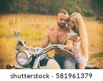 lovers on a motorcycle in a... | Shutterstock . vector #581961379