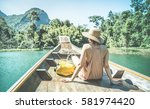 young woman traveler on... | Shutterstock . vector #581974420