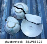 broken bowls on steel floor | Shutterstock . vector #581985826