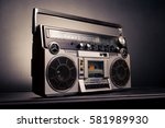 vintage radio boombox on dark... | Shutterstock . vector #581989930