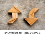 tangram puzzle as two way arrow ... | Shutterstock . vector #581992918