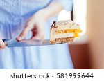 cutting delicious creamy brown... | Shutterstock . vector #581999644