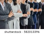 businesswomen and businessmen... | Shutterstock . vector #582013396