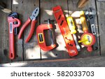 toy tool on wood | Shutterstock . vector #582033703