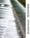 the cascade. overflow dam on... | Shutterstock . vector #582034300