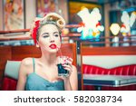 pin up girl in retro cafe | Shutterstock . vector #582038734