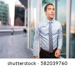 doubtful young businessman... | Shutterstock . vector #582039760