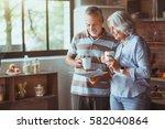 positive aged loving couple... | Shutterstock . vector #582040864